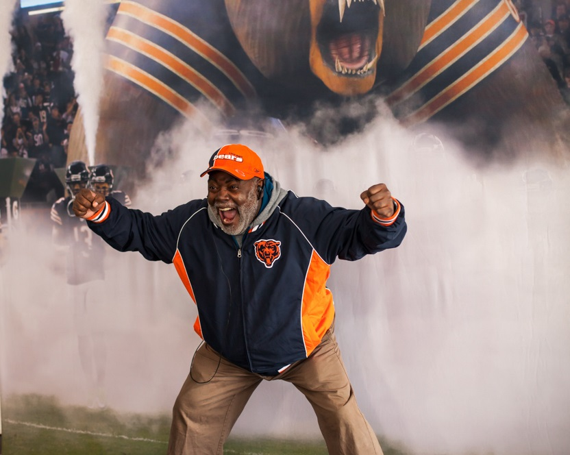 A Chicago Bears fan shows his passion at the FoxTales kiosk.