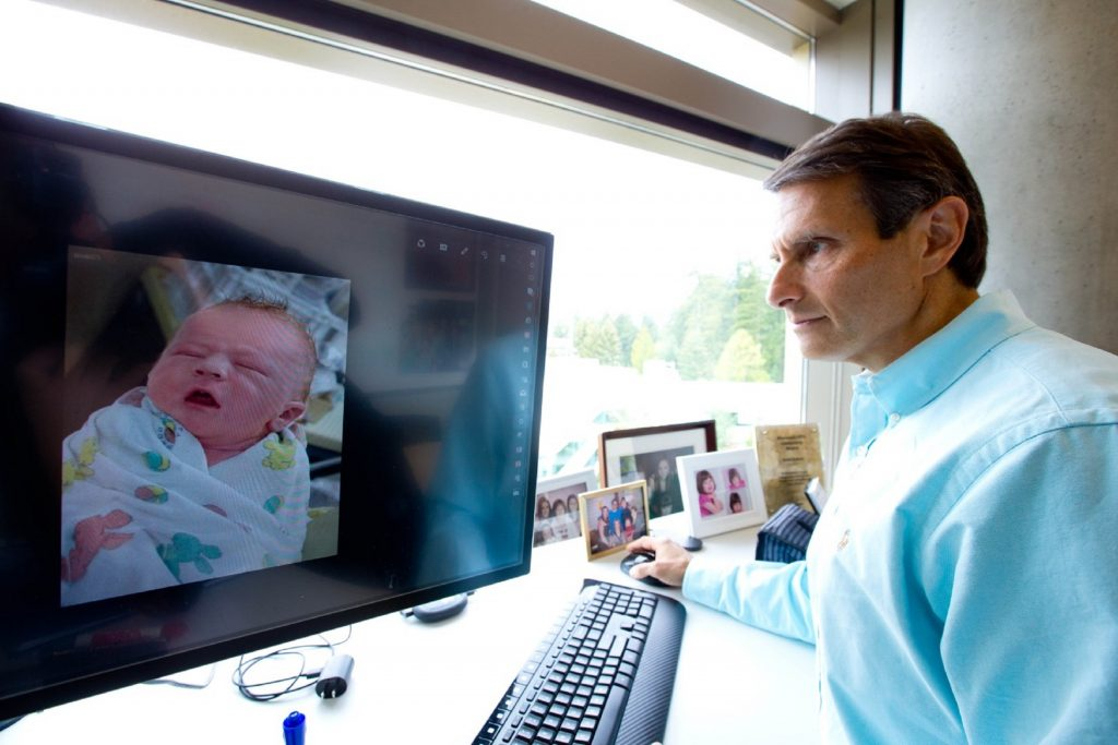 John Kahan in his office at Microsoft, with a photo of his son, Aaron, on the computer screen. (Photo by Scott Eklund/Red Box Pictures) Read more at https://blogs.microsoft.com/firehose/2017/06/07/a-gift-of-knowledge-that-could-help-save-the-lives-of-children-who-may-be-susceptible-to-sids/#4BeR8dfBrjwCJJIQ.99