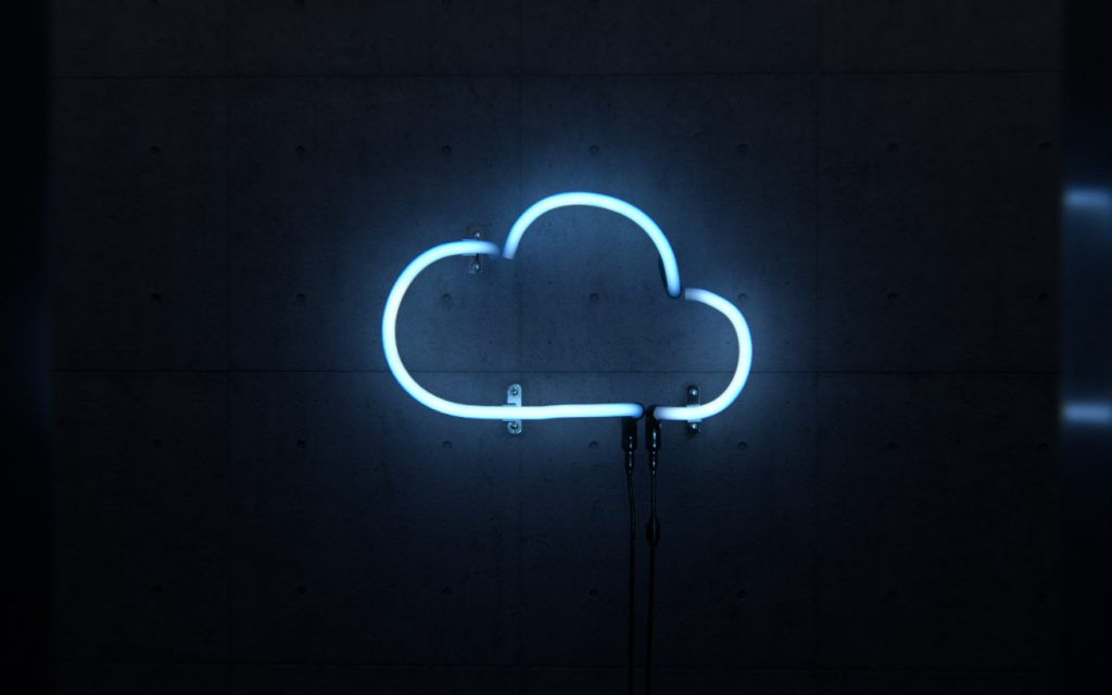 A neon sign in the shape of a cloud
