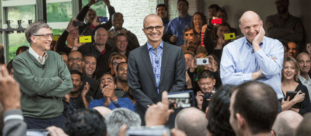 Photo of Satya Nadella, flanked by Bill Gates and Steve Jobs