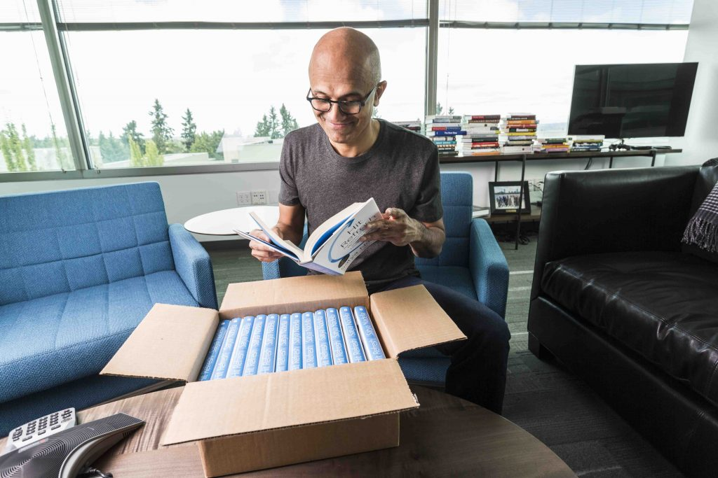 Microsoft SEO Satya Nadella in his office reading one of the first arrivals of his new book.