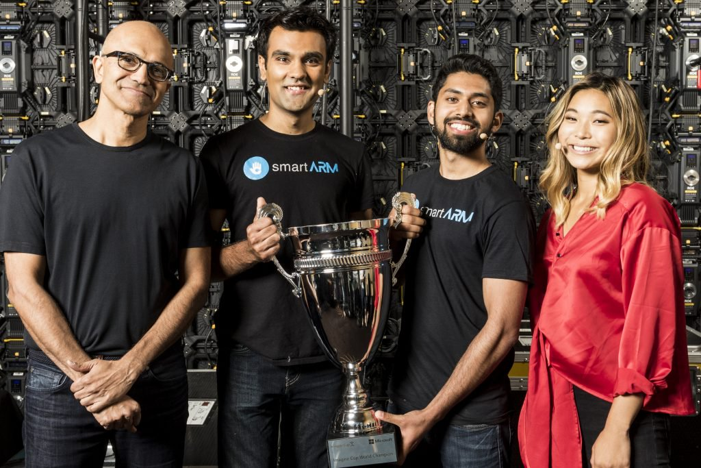 Satya Nadella with the smartARM team, 2018 Imagine Cup winners, and Chloe Kim, special guest and Olympic snowboarding gold medalist.