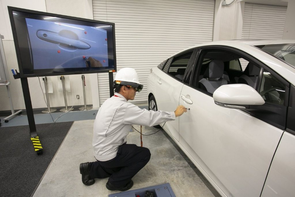 "A Toyota engineer uses Microsoft HoloLens to perform a process called ""film coating thickness inspection"" to manage the thickness of the paint for consistent coating quality on every vehicle."