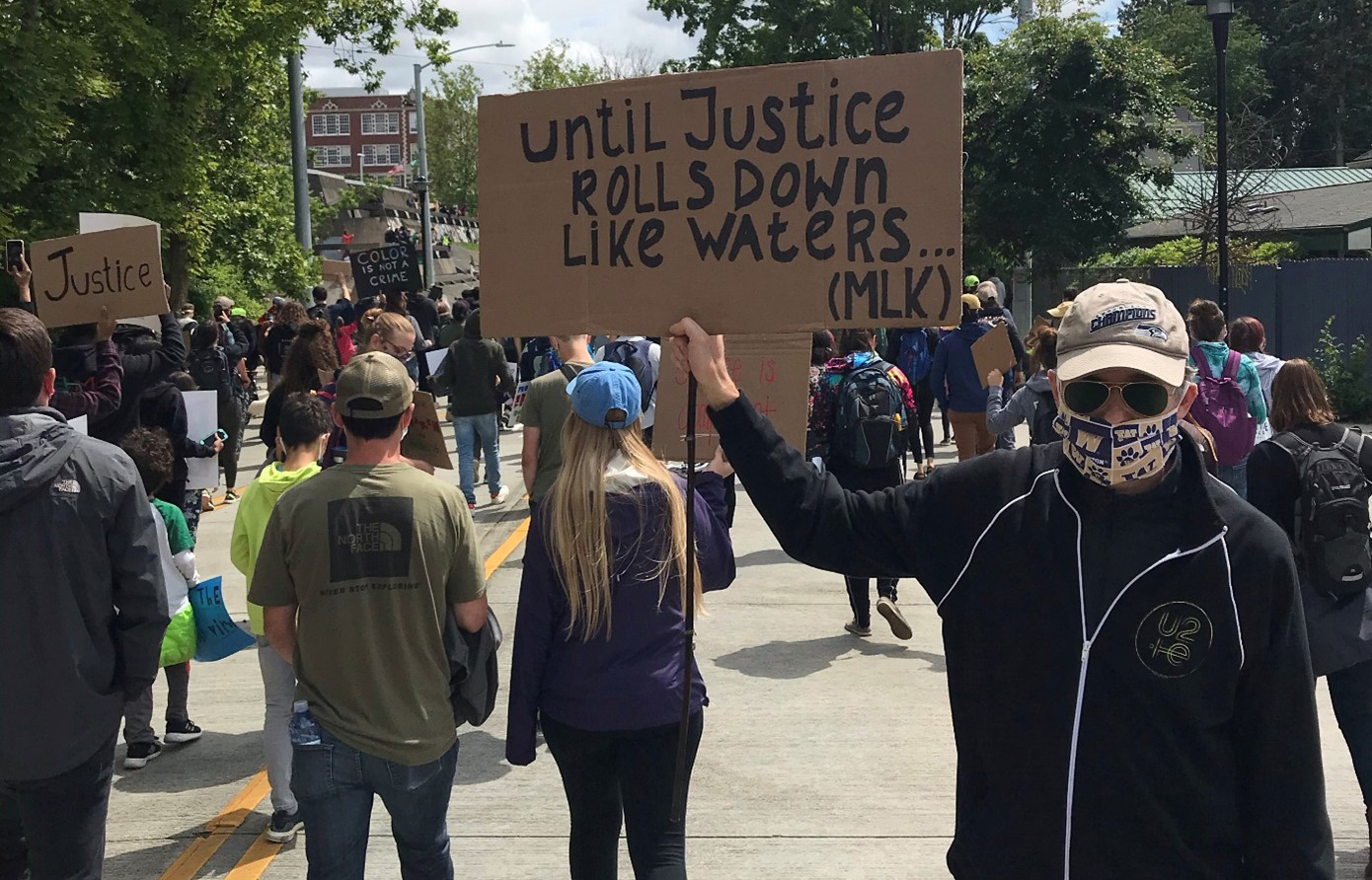 Man holding protest sign