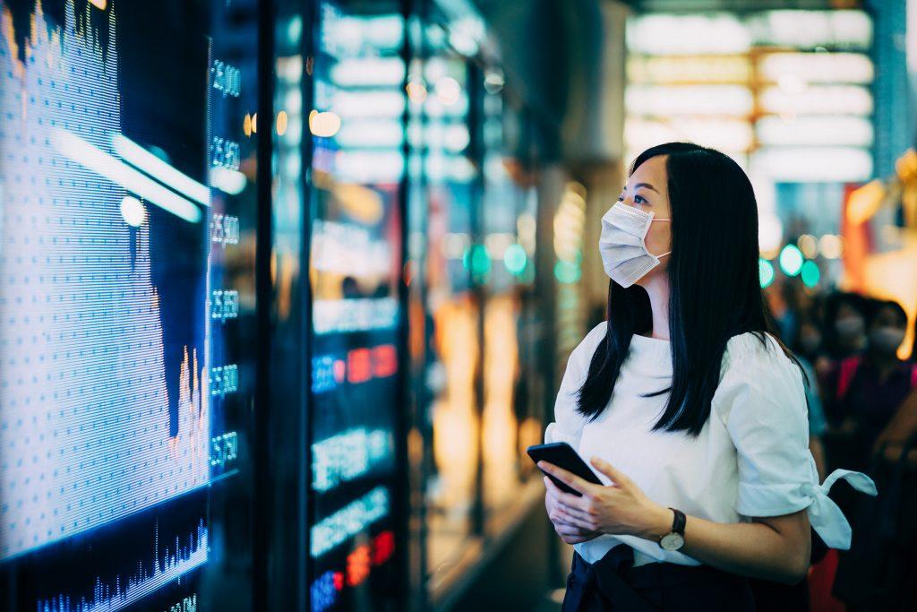 Woman viewing financial trading data