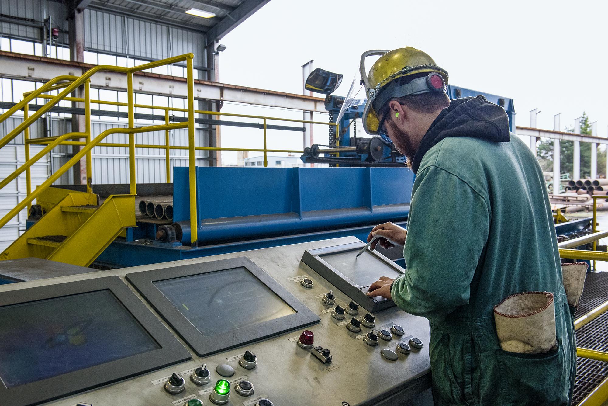 Man working machine controls
