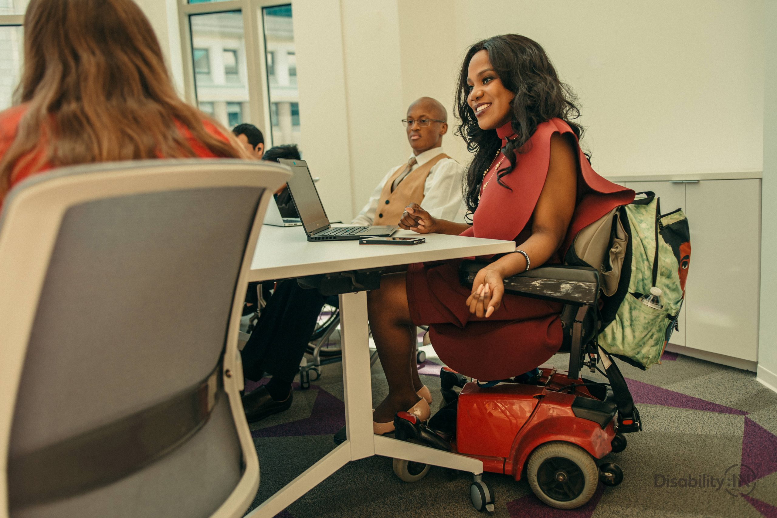 Woman in wheelchair at conference table