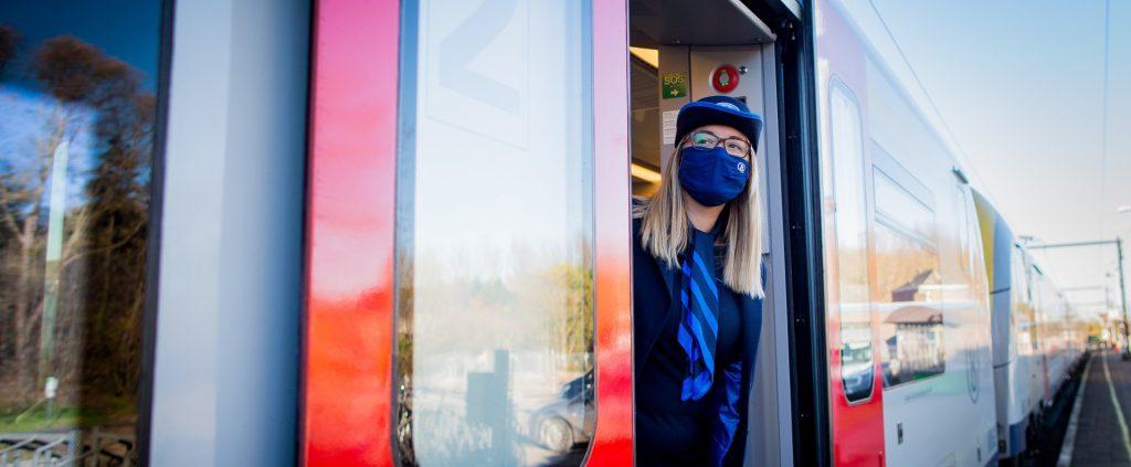 Woman in train door
